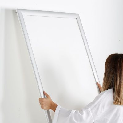 Portable 1.77 Snap Frame, mitred, 27x40, silver, white backing, clear cover-17