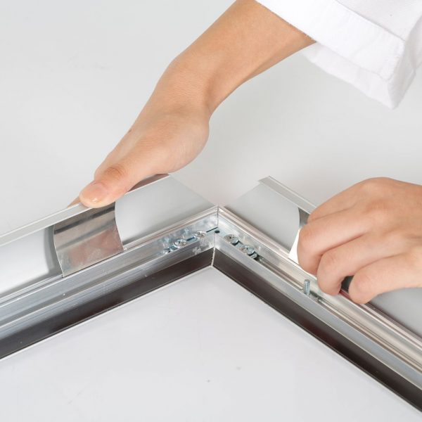Portable 1.77 Snap Frame, mitred, 27x40, silver, white backing, clear cover-5