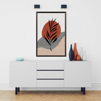 A geometric piece of art hung in a snap frame above a white dresser