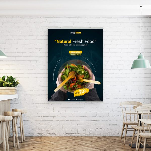 large poster hanging on a white brick wall in a small restaurant